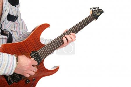 Closeup hands with guitar