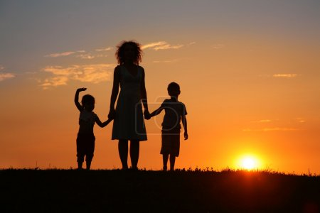 Photo for Mother and children on sunset silhouette - Royalty Free Image