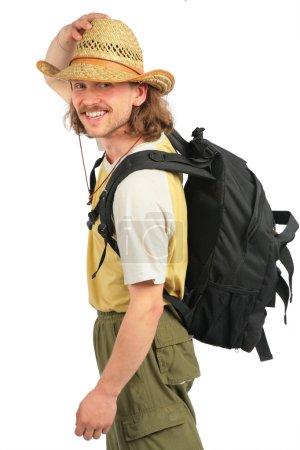 Photo pour Voyageur avec sac à dos en chapeau de paille - image libre de droit