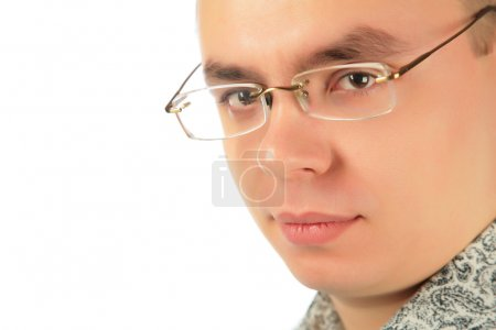Serious young man in glasses