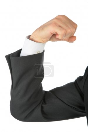 Clenched fist, arm in business suit