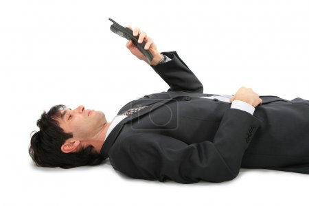 Lying on back businessman with phone