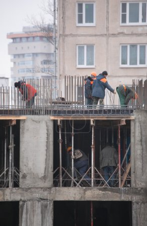 Workers construct building