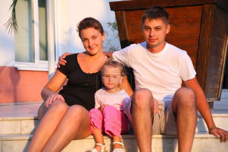 Family sits on steps