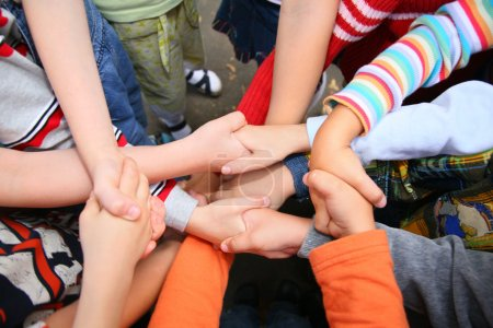 Photo for Children have crossed hands shakes - Royalty Free Image