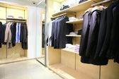 Clothes on racks in shop