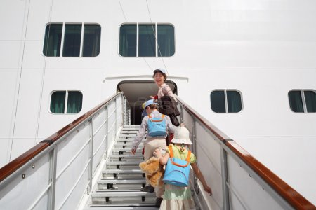 Little girl and boy with mother enter in large white passenger l