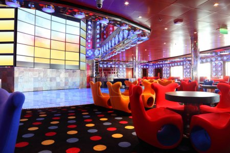 Cafe with bright multicolored interior and big screen on wall ge