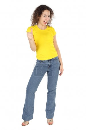 Young attractive woman in yellow shirt and jeans, ...