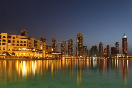 Dubai skyscrapers and other buildings at night time, view from w