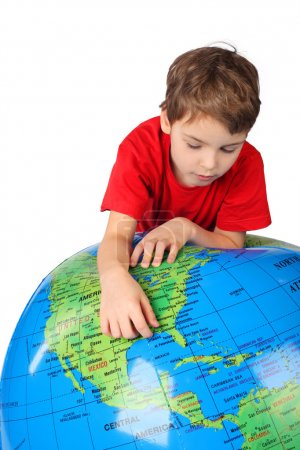 Photo for Boy in red shirt leans on inflatable globe isolated on white background - Royalty Free Image