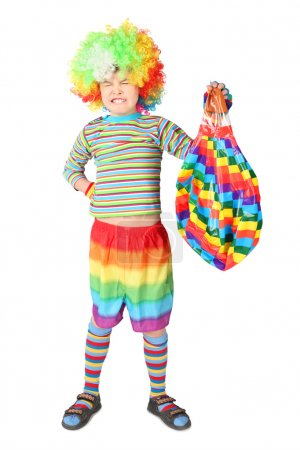 Boy in clown dress with multicolored baloon isolated on white ba