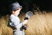 Boy with retro camera