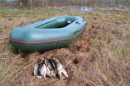 River fish near rubber boat...