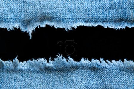 Ripped blue jeans with black space