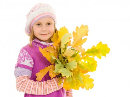 Girl with a bouquet of oak leaves on a white background.