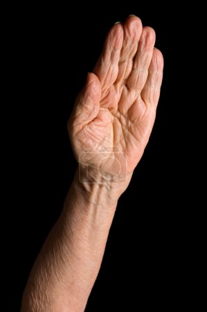 Photo for Hands of old woman on black background - Royalty Free Image