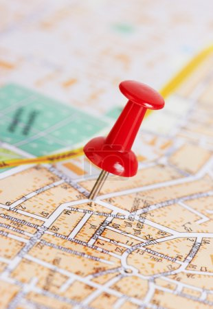 Red pushpin on a map