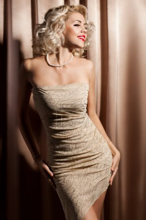 Beautiful fashionable woman in beige clothes