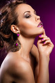 Elegant fashionable woman with violet jewelry