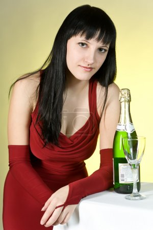 Photo for The girl in a red dress with a champagne glass - Royalty Free Image