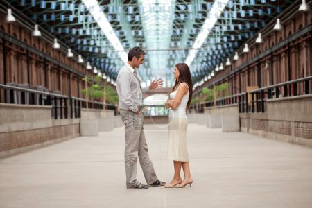 Photo for Full length of handsome man talking to beautiful woman - Royalty Free Image