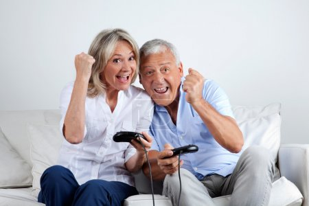 Photo for Senior couple having great time playing video game together - Royalty Free Image