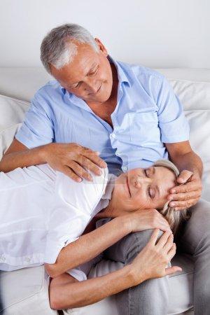 Wife Sleeping on Husband's Lap