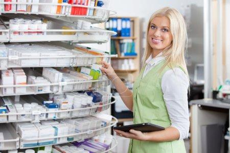 Female Pharmacist Holding Tablet PC