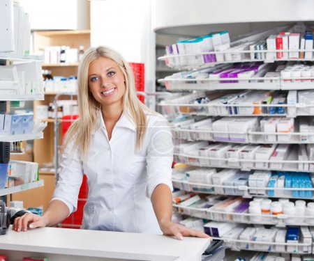 Photo for Portrait of smiling female pharmacist standing at checkout counter - Royalty Free Image