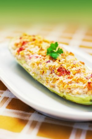 Photo for Zucchini stuffed with cheese, onions, garlic and tomatoes (shallow dof) - Royalty Free Image