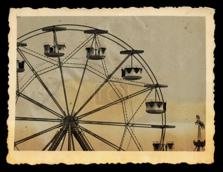 Vintage photo of ferris wheel in amusement park