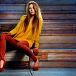 Young brunette woman portrait in autumn color...