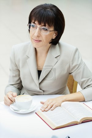 Woman glasses cup book
