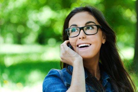 Cute woman glasses talking phone