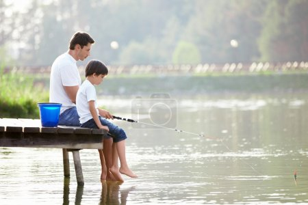 Photo for Man and boy fishing on the lake - Royalty Free Image