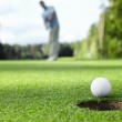 Golfer drove the ball into the hole...
