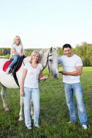 Photo for Family with a daughter with a horse - Royalty Free Image