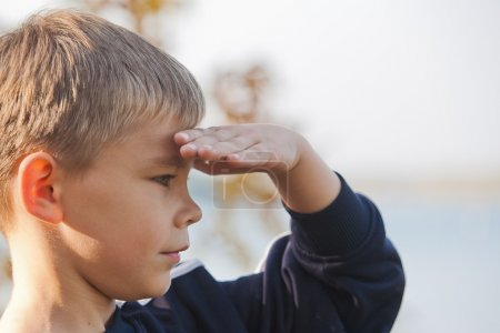 Boy looking at a distance