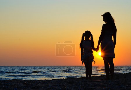 Photo for Mother and daughter walking on the beach - Royalty Free Image