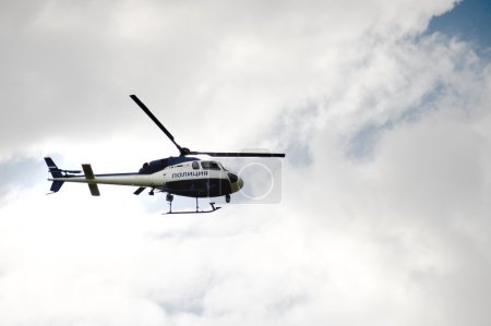 Police helicopter on the cloudy sky