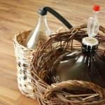 Bottles of homemade wine in wicker baskets...