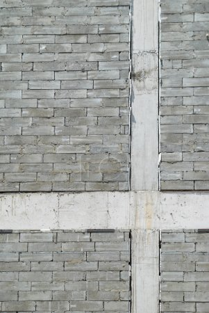 Photo for A wall of textured gray construction bricks. - Royalty Free Image