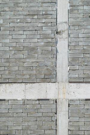 Photo pour Un mur de briques de construction gris texturé. - image libre de droit