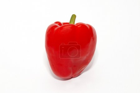 Red paprika isolated on white.