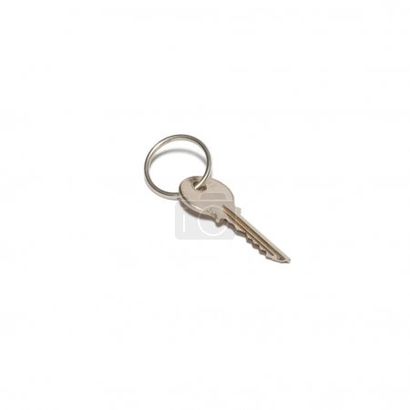Silver key isolated on white.