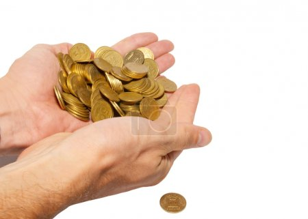 Many coins in cupped hands isolated on white.