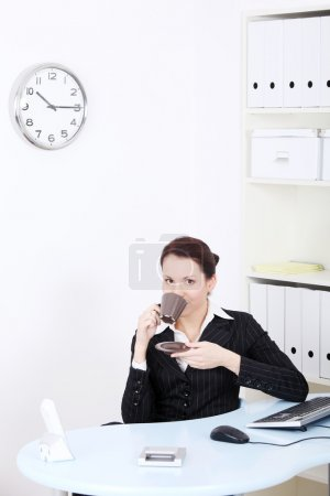 Beautiful business woman during her coffee break.
