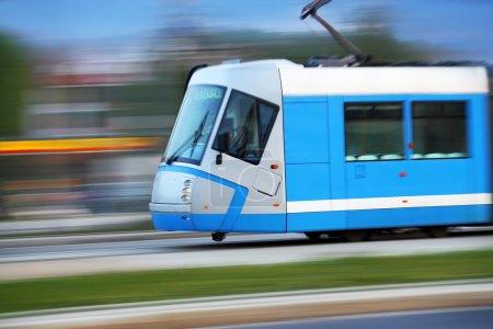 Modern blue tram rider fast on rails, Wroclaw, Pol...