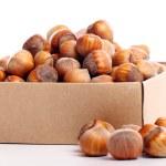Постер, плакат: Close up of hazelnuts in box
